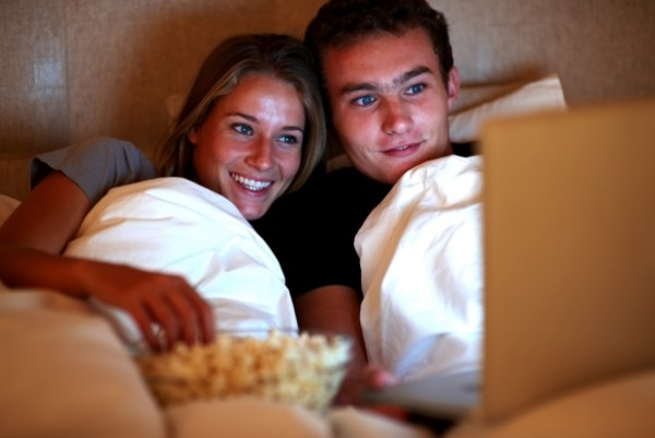 couple watching tv movie netflix bed