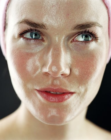 Young woman with shiny face, close up