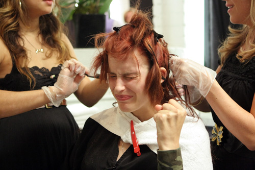 An America's Next Top Model contestant getting a haircut.
