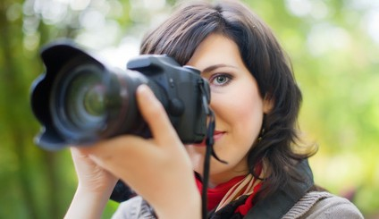 beautiful female photographer with camera outdoor
