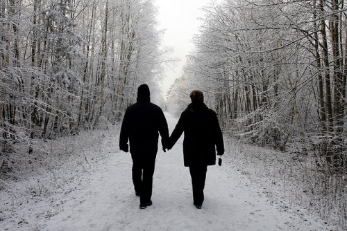 A couple walking in a winter wonderland.