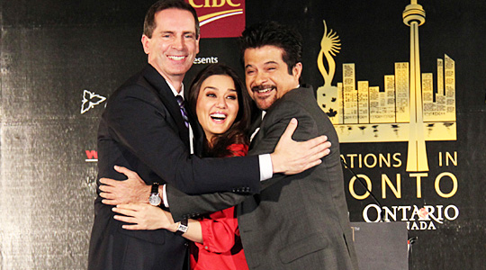 IIFA Awards in Toronto Preity Zinta and Anil Kapoor hug Dalton McGuinty