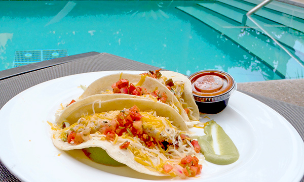 Poolside fish tacos at Tudor House in Miami Beach