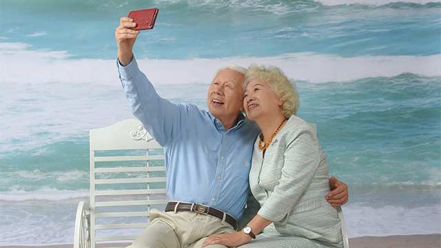 Elderly Grandparents on Beach Vacation Selfie