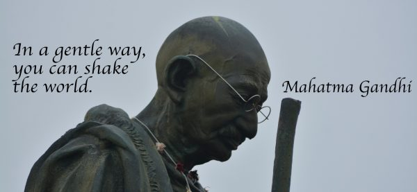 Statue of Mahatma Ghandi with quote In a gentle way, you can shake the world