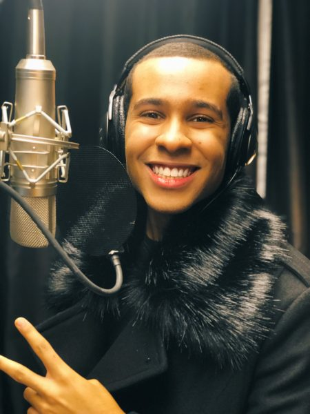 Anthony Brown in front of studio microphone