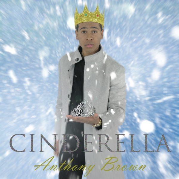Anthony Brown wears gold crown and holds glass slipper, Cinderella written in large caps