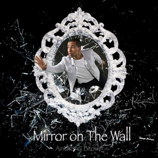 Anthony Brown stepping through a white lacy mirror frame, words Mirror on The Wall