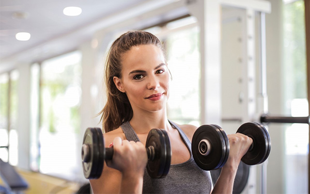 woman working out fitness weights