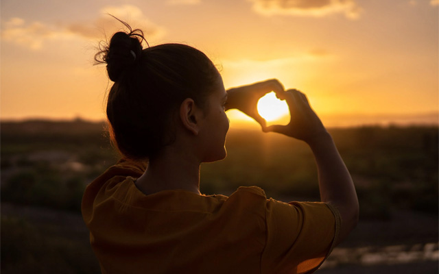 woman loves sunsets travel